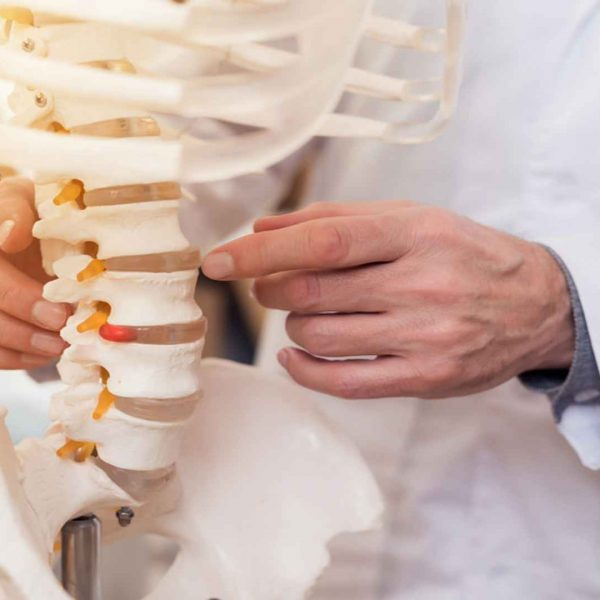 Doctor Showing Vertebrae Of Spine - Chiropractic Care - Henry Chiropractic - 1602 N 9th Ave, Pensacola, FL 32503 - (850) 435 7777 - https___drcraighenry.com